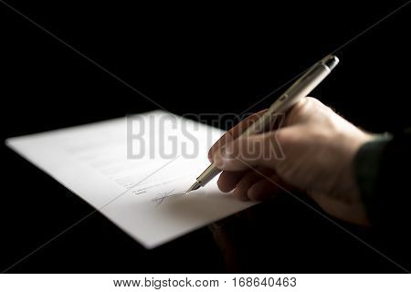 Closeup Of Businessman Signing Document Or Legal Papers