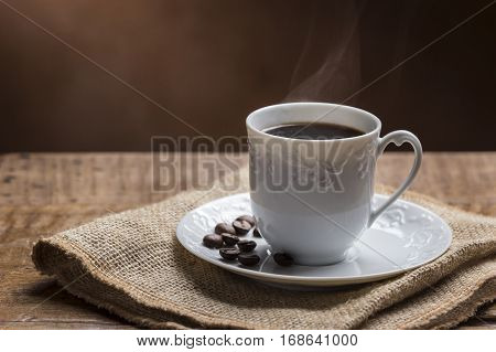 Cup of Coffee with Smoke/ Cup of Steamy Coffee with smoke on wooden table