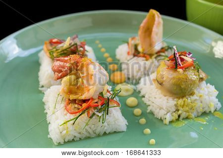 shrimp, fish, squid, Rice with Seafood on black background
