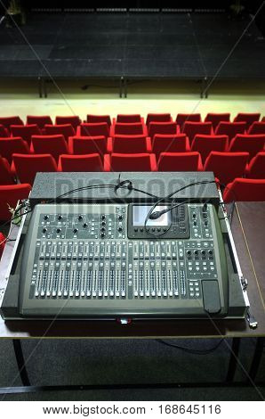 Old sound mixer in a small concert hall