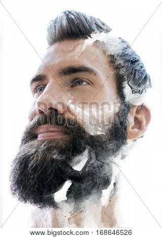 Good looking bearded male looking into the distance in contemplation