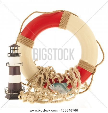 Lifebouy and fishing net with lighthouse
