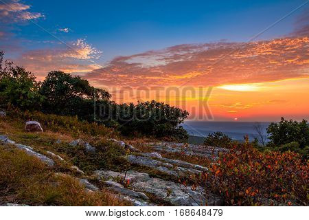Rocky granite outcroppings reflect a beautiful sunset sky at the top of New Jersey at High Point State Park