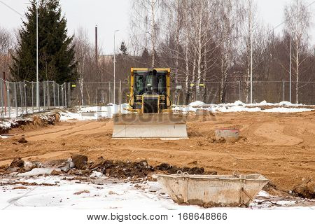 Bulldozer at work on new construction site