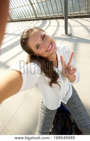 Young Happy Woman Taking Selfie Showing Peace Sign