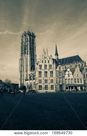The main market square with the St. Rumbold's cathedral in the background in Mechelen or Malines in Belgium - monochrome