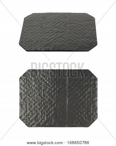 Octagonal sheet of black waxed cardboard paper isolated over the white background, set of two different foreshortenings