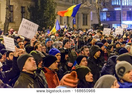 BRASOV ROMANIA - 1 FEBRUARY 2017: Massive protests in Brasov against planned measures aimed to defend corrupt officials. Some 20.000 people marched through the Brasov city and 150.000 in Bucharest Romanian capital and a total of 400.000 all over Romania.