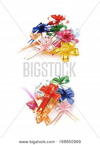 Pile of foldable tape bows isolated over the white background, set of two different foreshortenings
