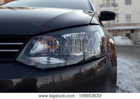 car headlights close up. Front glass lantern