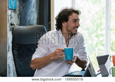 Employee in creative industries having coffee and talk