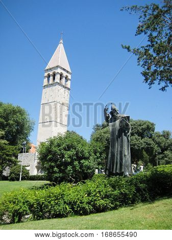 Gregory of Nin statue and bell tower in Diocletian's Palace in Split, Dalmacia province, Croatia. Popular tourist attraction - rubbing his big toe considered to be a good luck.
