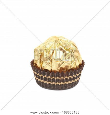 Single confection candy in a golden wrapper isolated over the white background