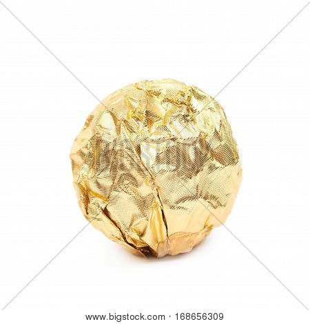 Ball confection candy in a golden foil wrapper isolated over the white background