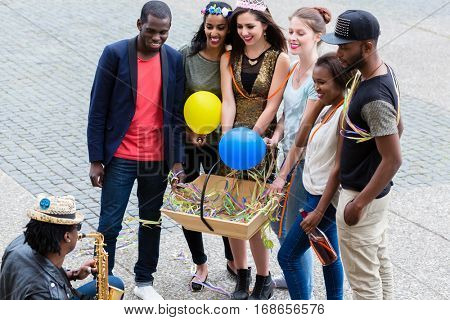 Multi-ethnic group on a bachelorette party, men and women together