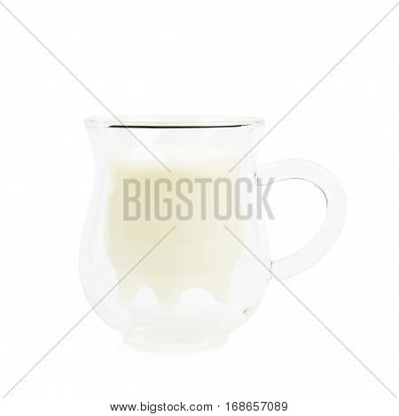 Cow's udder shaped glass cup filled with milk, composition isolated over the white background