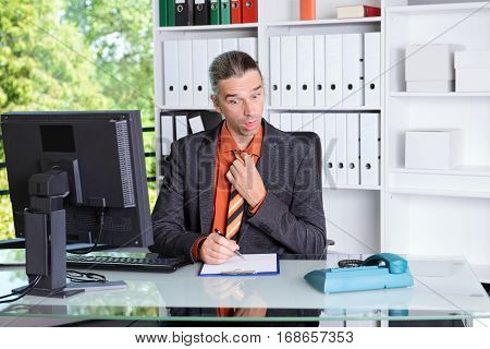 Business Man Looking Amazed At Desk