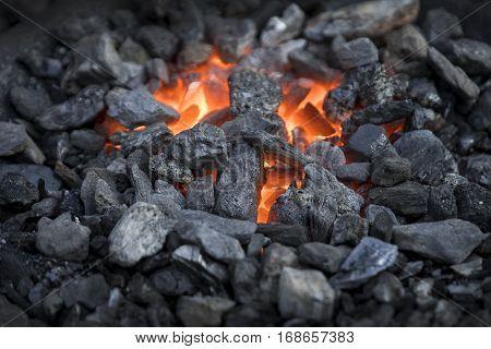 Blacksmiths coals burning for iron work