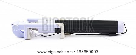Folded selfie stick isolated over the white background