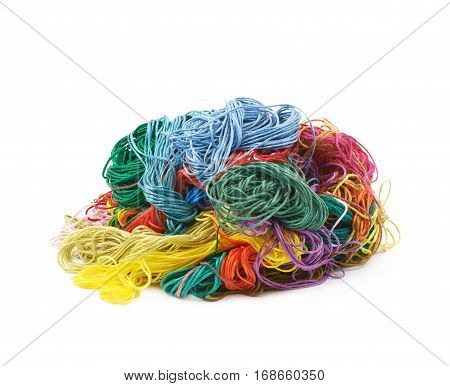 Mixed pile of colorful yarn threads isoalted over the white background