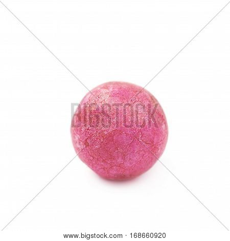 Single pink colored foam ball or a corn cereal candy isolated over the white background