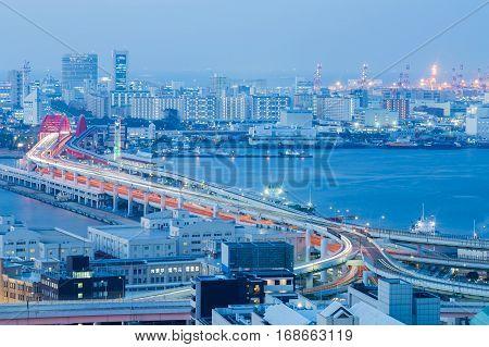 Kobe city road aerial view over sea port at twilight Japan