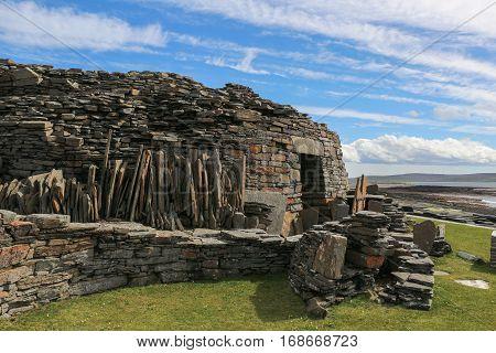 Prehistoric drystone Midhowe Broch on Rousey Island, Orkneys, Scotland, on Eynhallow Sound