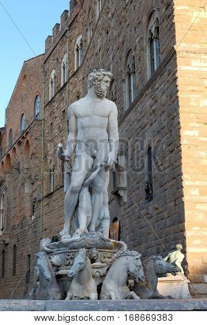 A statue of Neptune in Piazza della Signoria in Florence Italy. The Historic Center of Florence is in the UNESCO World Heritage List.