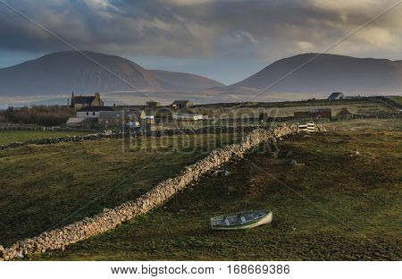 Orkney farms and view of hills on Hoy from Brinkie's Brae, Stromness, Scotland