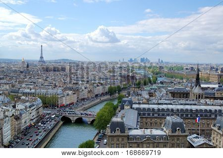 Aerial view of Paris with the Eiffel tower Louvre river Seine and La Defense in the distance France.