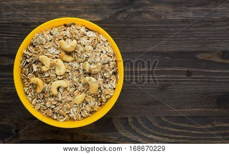 Oatmeal With Walnuts. Oatmeal On A Wooden Table. Oatmeal Top View. Healthy Food .