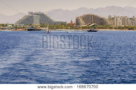 View on the central beach of Eilat - famous resort city with thousands relaxing tourists from around all the world
