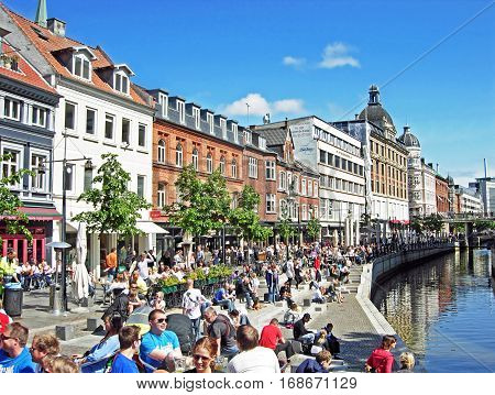Aarhus, Denmark - June 6, 2009: Many people enjoying a sunny day at Aboulevard, the promenade along the river Aarhus A. Aarhus is located in the region Midtjylland and with about 260,000 inhabitants, the second largest city in Denmark.