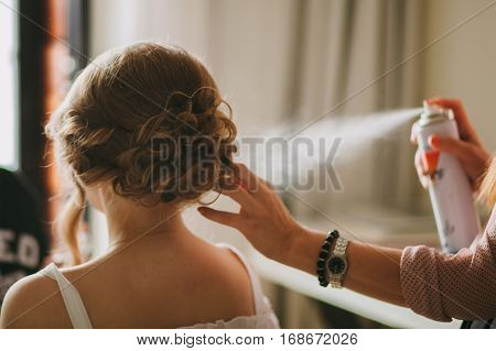 bride getting ready. Bride doing hairstyle. Wedding