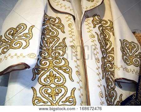 The embroidered pattern on the national Kazakh a bathrobe