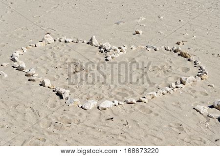 Heart drawn in the sand sand backgrounds and texture.