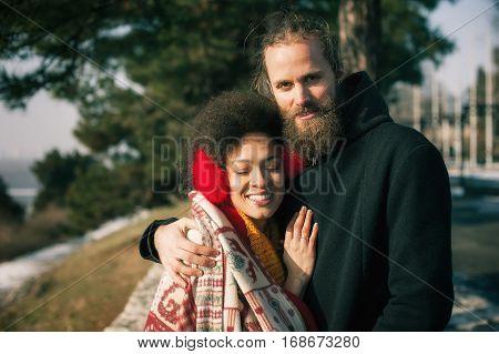 Romantic Multiethnic Couple In Love Hugging On The Street