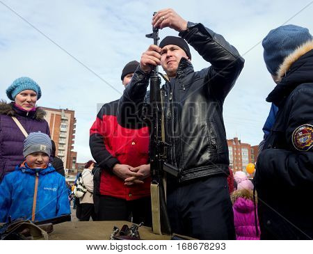 Sosnovy Bor, Russia - March 13 2016: Assembling disassembly of the Kalashnikov assault rifle on the City Day celebrations