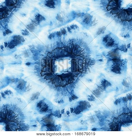 Seamless tie-dye pattern of indigo color on white silk. Hand painting fabrics - nodular batik. Shibori dyeing.