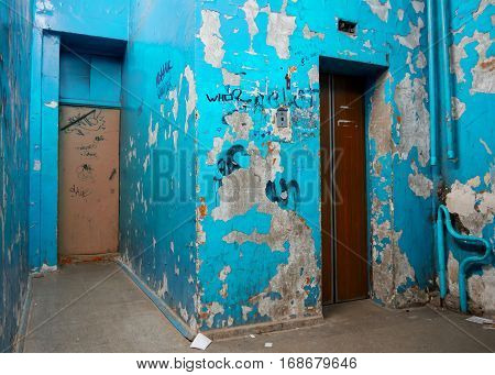 Shabby entrance wall in the usual Russian residential house