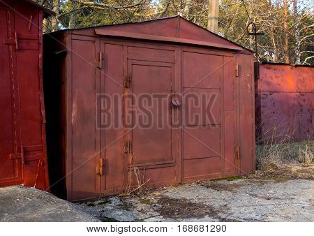 Old garage made of metal sheets and profiles