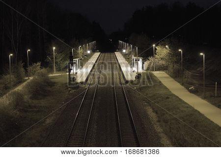 Small trainstation in germany after sundown dark