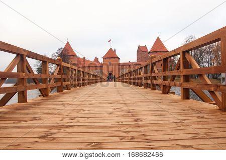 The bridge to Trakai Peninsula Castle Museum on the island. Trakai village of Karaites, Lithuania, Europe. Lithuanian landmark in late autumn