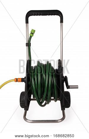 Carrying a black for hose with a green and yellow hose isolated white background with soft shadow. Close-up
