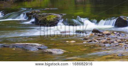 Wilson Creek in North Carolina rolling over a line of rocks