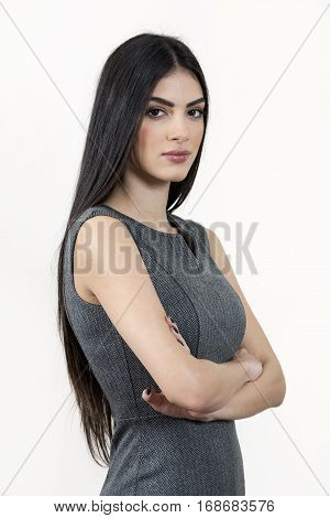 Young Business Woman Standing With Arms Crossed.