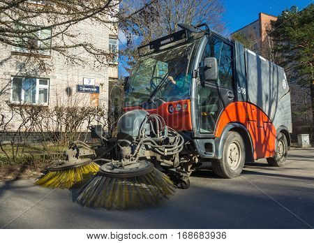 Sosnovy Bor, Russia - April 11 2016: Cleaning streets of the city with the help of subcompact sweeper