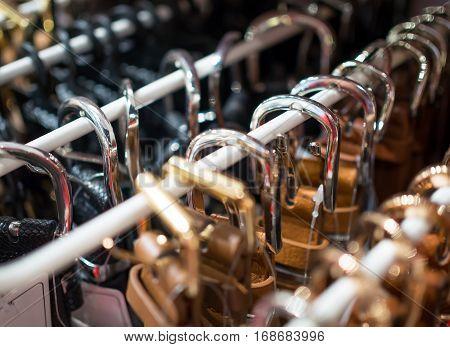 Glittering buckles waist belts on the rack