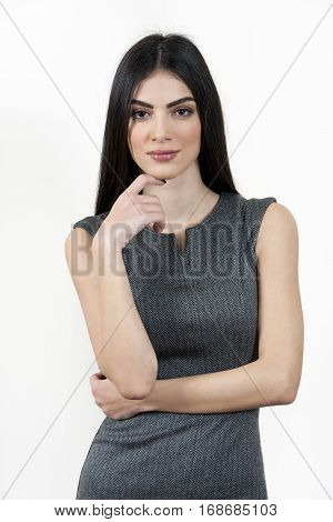 Young Business Woman Standing With Hand On Chin.