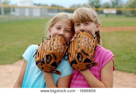 Two twin sisters enjoying their baseball game. poster